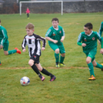 Ammanford wing man Osian Davies on another attack